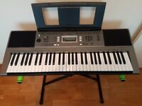 Yamaha PSR-E353 keyboard with GRAVITY stand.