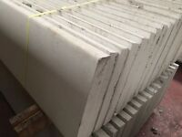 Smooth face base panels, gravel boards