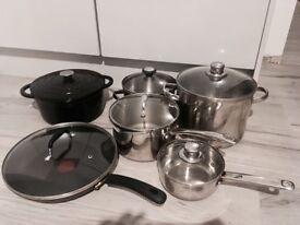 4 alluminium pots and 1 cast iron pot & and a non-stick teflon pan