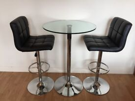 Glass Bar Table and two Black Leather Bar Stools
