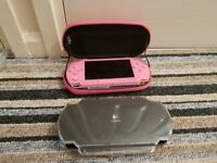 Pink psp with 2 cases, charger and games
