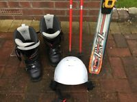 Skis, boots, poles and helmet for sale in good condition.