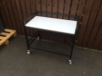 metal trolley with wooden top good condition with four wheels