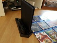 1tb playstation 4 with 1 wireless controller and charging dock with 9 games