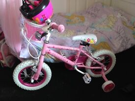 Girls bike with stabilisers and helmet and shine pads and elbow pads