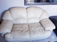 Free, leather 2 seater cream sofa
