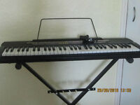 Casio CTK-520L Electronic Musical Keyboard, included power adaptor and stand as in photos