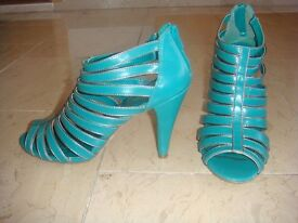 Green gladiator style heeled shoes