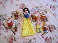 Snow white doll and seven dwarfs