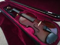 Violin in new condition, full size. With super case, bow, rosin, mute, & shoulder brace. Bargain!