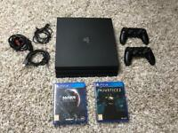 PlayStation Pro 1TB with two games