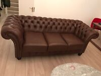 Genuine high quality leather Sofas and an arm chair.