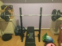 Weights including olimpic bar 100kg and 40 kg weight with curl bar plus dumbbells all plates