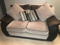 grey and black two seater sofa and armchair