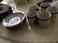 Small cups along with matching saucers