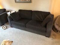 3 piece suite. 3 seater, large armchair footstool. Dark grey