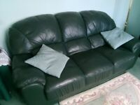 Dark green 3 seater leather settee and matching armchair- excellent condition