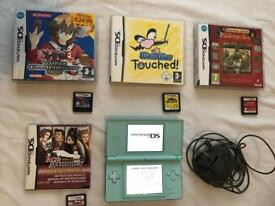 Nintendo 2DS Lite , Charger and 4 games