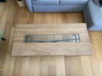 Large solid coffee table with glass panel and metal legs