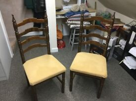 2 solid dark wood chairs with newly reupholstered gold seats