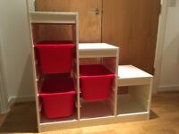 IKEA Trofast Toy storage unit with red storage boxes