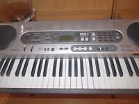 Casio LK - 70s Electronic Keyboard and Stand