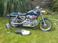 Custom Harley 883cc Sportster. Silver and Blue Paint Work with single dule seats and sissy bar
