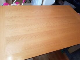 Extendable oak effect table