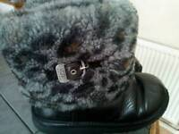 Original 100% Ugg boots. Black leather with fur inside. Size 5.5 Great condition
