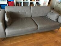 Large grey 2 seater sofa.