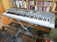Yamaha Keyboard DGX 220 with stand and box.