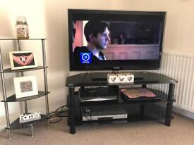 Tv stand and 3 tier display until glass black very good condition