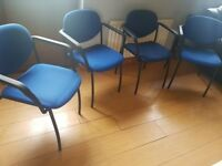 blue executive office chairs with armrests