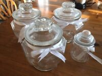4 glass canisters, 3 large 1 small