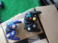 pair of original game cube controllers