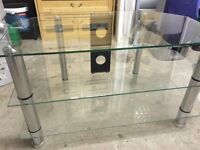 Glass & Chrome TV stand,Three shelves,it's in perfect condition no chips or scratches