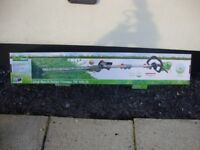 Long reach electric hedge trimmer used once, as new with box