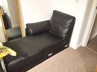 Black faux leather corner arm chair, immaculate condition!