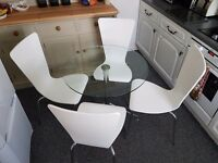 Glass dinning table and 4 chairs