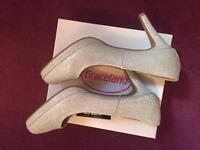 Shimmer Gold platform heel shoe size 9 wide fits.