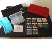 Red nintendo dsi with games and accessories