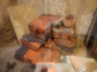 Aprox 800 whole and half red bricks from Victorian terrace, thin render on one side of many