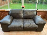 2 Seater Brown Leather Sofa in solid condition. Collection only.