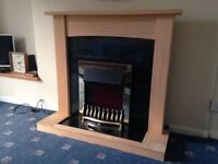 Dimplex electric flame effect fire with solid wood surround.