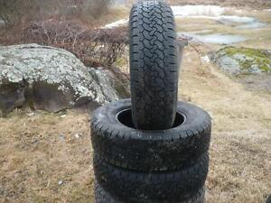 Four matching Lt 245-75-17 tires $200.00