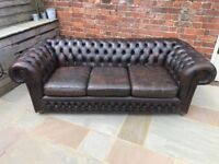 Brown Leather Chesterfield. 1 Three Seater and 2 Club Armchairs