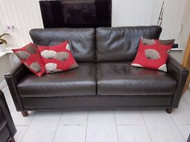 Brown leather John Lewis sofa, matching armchair & footstool with dark wooden feet. Good condition