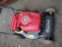 MOUNTIELD PETROL LAWNMOWER STARTS AND RUNS MAY NEED A SERVICE NO GRASS BOX HENCH ONLY £25 QUICK SALE