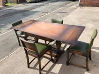 extendable table and 4 green chairs