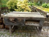 antique wooden workbench with vice